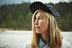 Portrait of woman wearing cap headwear - stock photo