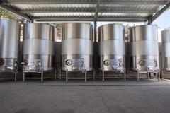 Metal vats in vineyard - stock photo