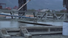 Process of pouring and flattening wet concrete Stock Footage