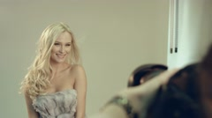 Happy blonde being photographed for a famous magazine in the studio Stock Footage