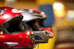 Go carting crash helmets in a row - stock photo