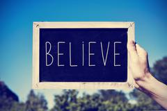 Chalkboard with the text believe, filtered Stock Photos