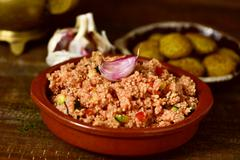 couscous with vegetables and falafel - stock photo