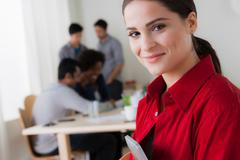 Portrait of young woman in office Stock Photos