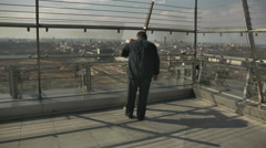 Viewing Platform on the Roof of a Building. Man with binoculars Stock Footage