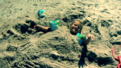 Girl Buried In Sand At The Beach Stock Footage