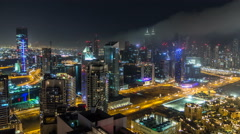 Scenic aerial view of a big modern city at night timelapse. Business bay, Dubai Stock Footage