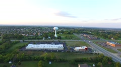 Aerial towards water tower in suburban Ohio Stock Footage