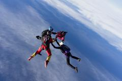 Small group of skydivers in formation Stock Photos