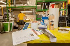 Ink and swatches on bench in screen printing workshop Stock Photos