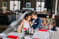 Portrait of a beautiful embracing couple  in vintage cafe. Wedding day. Close - stock photo
