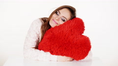 Woman gorgeous girl hugging red heart love symbol 4K Stock Footage