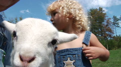 Farmer With Baby Lamb and Grandson Stock Footage
