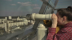 Woman with binoculars. Viewing Platform on the Roof of a Building.  Stock Footage