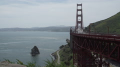 View of bridge and large rock Stock Footage