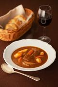 Still life of casserole in bowl with red wine and bread Stock Photos