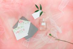 Beautiful wedding invitation. Details from polygraphy, flowers and perfumes. Stock Photos
