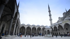 People in the park near the mosque Stock Footage