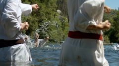 Group practice Karate on river Stock Footage