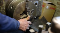 The man working on a lathe Stock Footage