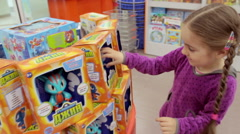 Little girl in toys department store 5, Model Release - stock footage