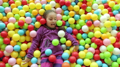 Small Girl In Ball Pool Stock Footage