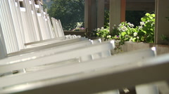 Front Porch Rocking Chairs In Morning Light Stock Footage