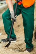 Manual worker with shovel - stock photo
