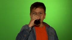 Kid Drinks Juice Stock Footage