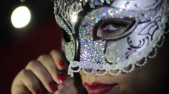 Sexy woman puts venetian mask disguise Stock Footage