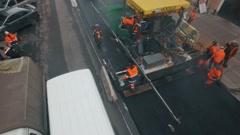 RUSSIA ST.PETERBURG- aerial view of road workers laid asphalt in the Stock Footage