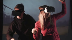 Man and woman in VR oculus rift on rollercoaster Stock Footage