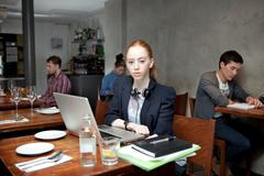 Student in cafe with laptop, portrait - stock photo