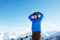 Portrait of boy with hands on head, Les Arcs, Haute-Savoie, France - stock photo