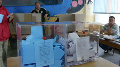 Two transparent ballot boxes close up, people voting on republican elections. Stock Footage