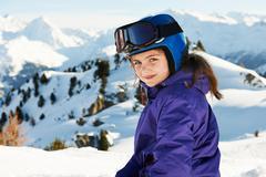 Portrait of girl in ski gear, Les Arcs, Haute-Savoie, France - stock photo