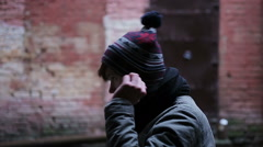 Miserable young man putting on hat, teenager blowing to warm up cold hands Stock Footage
