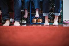 Child and parents with bare feet, low section Stock Photos