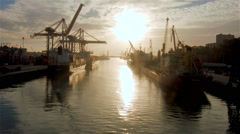 Time-lapse of cargo ship moving load at port Stock Footage