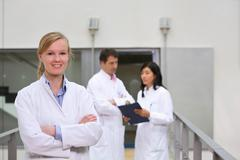 Group of  scientists in atrium - stock photo