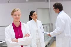 Group of scientists in laboratory atrium - stock photo