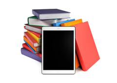 Pile of books with a tablet in the foreground Stock Illustration