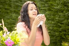 Girl about to sneeze into tissue Stock Photos