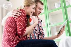 Couple on video chat using digital tablet Kuvituskuvat
