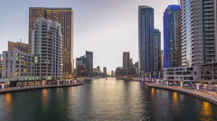 View of Dubai Marina Towers and canal in Dubai day to night timelapse Stock Footage