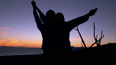 Young couple admire sunset near sea, super slow motion 240fps - stock footage