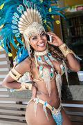 Samba dancer on cellphone, Rio De Janeiro, Brazil Kuvituskuvat