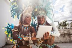 Samba dancers in costume, using digital tablet, Rio De Janeiro, Brazil Kuvituskuvat