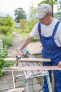 Man doing carpentry work - stock photo