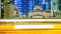 Mosque among modern high rise buildings, towers and hotels timelapse at Dubai Stock Footage
